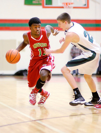 Anderson's Chirs Lemon drives as he is guarded by Pendleton Heights' Sean McDermott for the County Championship on Friday.