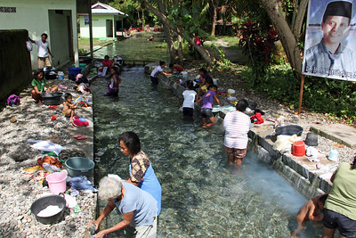 """besides being a public pool and home of """"magic"""" eels, the springs are also good for washing clothes. ambon"""