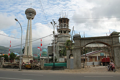 new mosque under construction, with the old one in the background. ambon