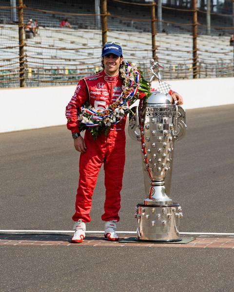 Dario Franchitti with the Borg Warner trophy...