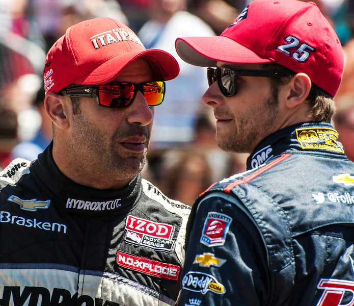 Tony Kanaan talks with Marco Andretti at the Indianapolis Motor Speedway...