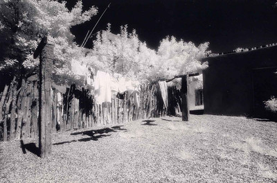 NEW MEXICO WASH DAY Still wandering around the place, I ran across this clothesline with all these wonderful white clothes hanging on it just begging to be shot in infrared. And so, of course, I had to oblige them. Those are some pretty heavy-duty clothesline posts, wouldn't you say?