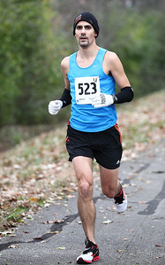 John Kruszka, from Avon, has a big lead and goes on to win the men's Inland trail marathon. photo by Ray Riedel