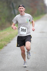 Mike Ryan has a long lead and wins first place in the 13.1 mile Inland Trail half marathon. photo by Ray Riedel