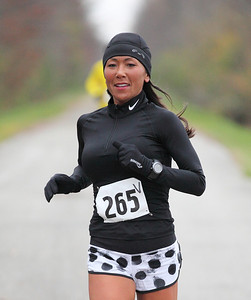 Joanie Washington of Sheffield Lake is in first place in the women's 13.1 mile Inland trail half marathon. photo by Ray Riedel