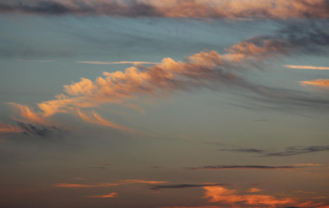 Gratuitous whispy clouds.