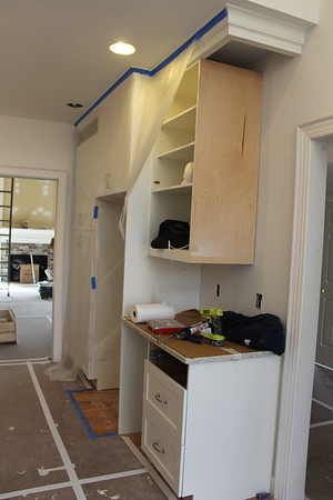 other side of kitchen where refrigerator will go (cabinet missing on edge)