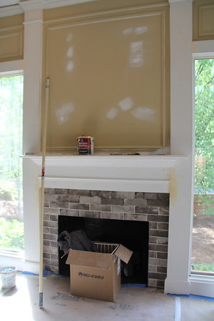"the fireplace - all the ""gold"" walls will be painted gray - the fireplace has gas logs and the brick facing is actually tile. They added 2 more rows, so are not finished with grout."