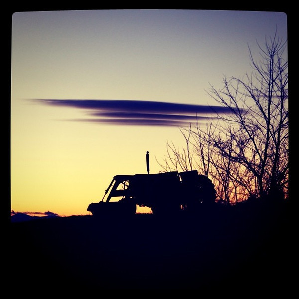 Cloud canopy over a tractor. #btv #Milton #silhouette #sunset