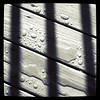 Water droplets behind bars. #fun #abstract #rain #silhouette