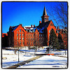 Red building, white ground, blue sky. #btv #vt #uvm