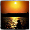 She's just checking out the #sunset. #Quebec #Canada #lake #golden #silhouette #girl #reflection