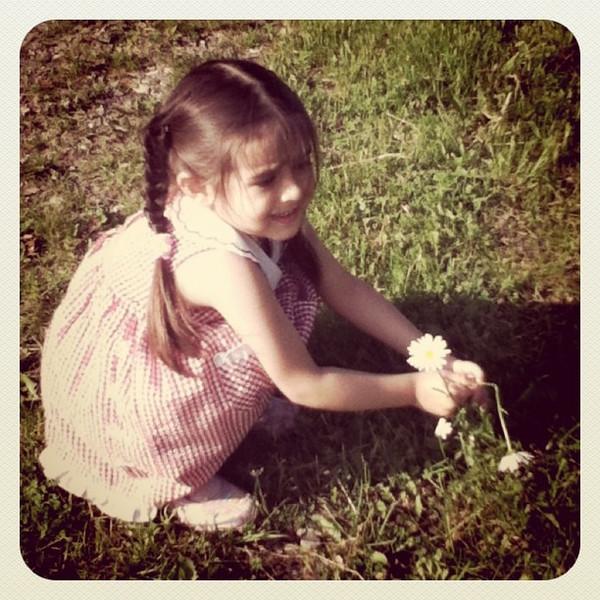 My cutie pie niece picking some flowers. #kid #flowers #fun #canada #everton #cute
