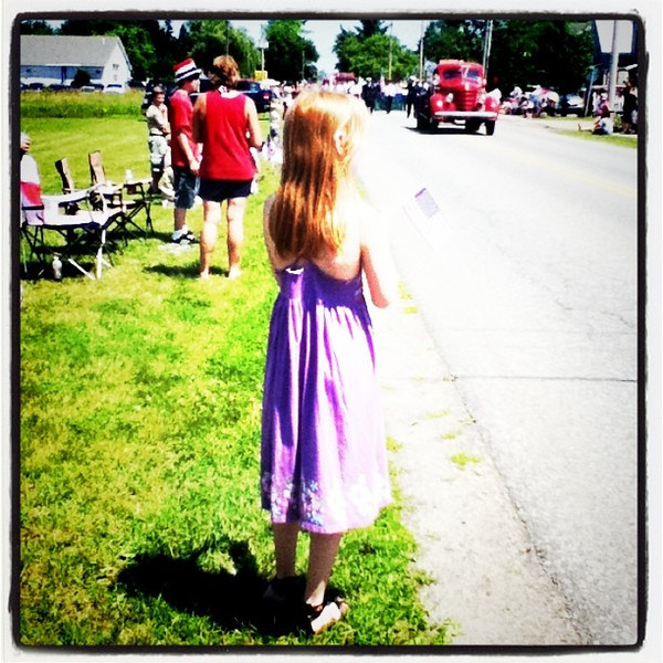Little girl waiting patiently for the #parade & #candy. #usa #patriotic #milton #vt