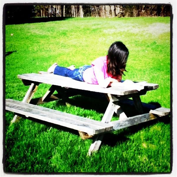 Beautiful day to read outdoors. #Milton #summer #kid