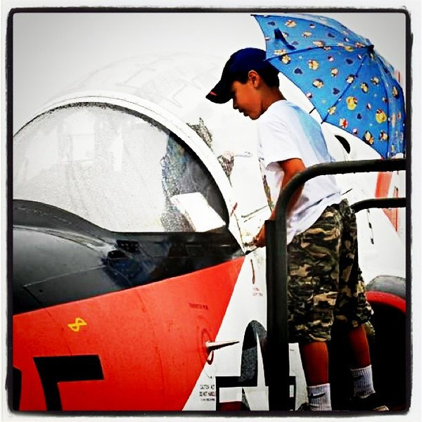 Future pilot with an umbrella. #kid #plane #aviation #military #airshow