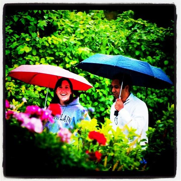 Loving couple at their wedding rehearsal in the rain.
