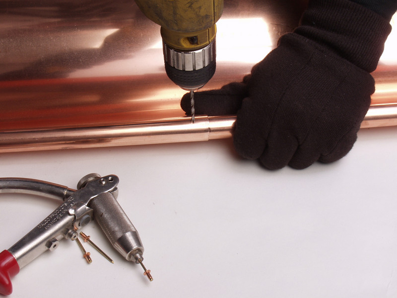 "Drill a 1/8th inch hole to accept a copper rivet.  <a href=""http://www.abraingutters.com"">http://www.abraingutters.com</a>"
