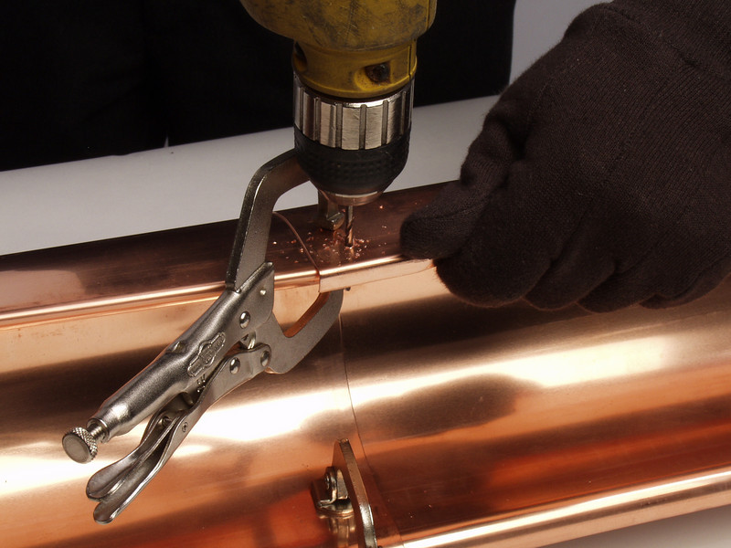 "Let the drill cut the metal without pressing too hard as this can cause the seam to distort.  <a href=""http://www.abraingutters.com"">http://www.abraingutters.com</a>"