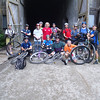 "The Big Group Shot at the tunnel entrance. First ""all unicycle"" International Harper Day. Not Standing, L to R: Luke, Scott, Kenny, Tom. Standing, L to R: JC, Miles, Tim, Jeff, Harper, Kevin, Sarah, Bruce, Dave, Shannon, Noli."