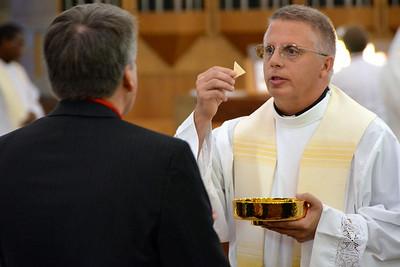 Msgr. Ross shares communion