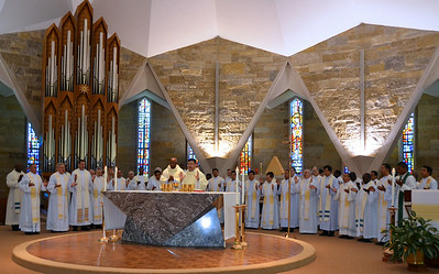Students and faculty gather around the altar