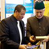 The Imam of the London Fazl Mosque, Ataul Mujeeb Rashid Sahib, presents prize draw winner various gifts of books and a Kindle.
