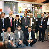 Group shot of some of the team and Jama'at guests with Amir Sahib, Rafiq Hayat.  (Photo courtesy of China Desk)