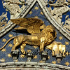 the winged lion of venice on the apex of the west facade of St Mark's basilica in Venice