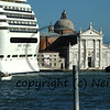 a huge tourist cruise liner passes right in front of st marc's square in Venice, Italy. This controversial practise is soon to be banned for fear of further damaging the venice waterfront