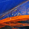 Detail of the plimsoll line of a boat, showing displacement markings in blue and orange
