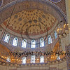 the half dome of a mosque showing beautiful tiles  and harmonious colors