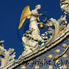 golden angel on the stairway of angels on the summit of the west facade of St Mark's basilica in Venice