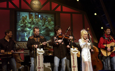 Country musician Dolly Parton sings a song on stage during a Grand Ole Opry live broadcast in Nashville, Tenn. as U.S. soldiers watch the show simultaneously in Iraq on April 23, 2005.  Secretary of Defense Donald. H. Rumsfeld also visited Nashville to thank Dolly Parton, the Grand Ole Opry and the American people for their support of our troops.  DoD photo by Tech. Sgt. Cherie A. Thurlby, U.S. Air Force.