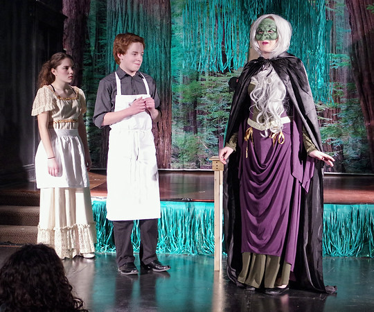 Mark Maynard | for The Herald Bulletin<br /> The Baker's Wife (Teddi Bishop) and the Baker (Tyler McCorkle) listen as the Witch (Christina Bambrough) lists the items they must gather for her in order to remove the curse which keeps them from having a child.