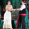 Mark Maynard | for The Herald Bulletin<br /> The Baker's Wife (Teddi Bishop) struggles with the Steward (Skylar Ellis) over Cinderella's slipper.