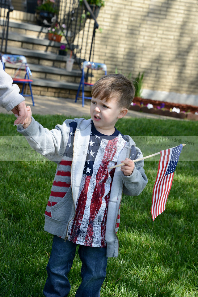 4 year old Danny Boyle watches the Isand Park Memorial Day Parade on Long Beach Road