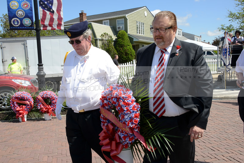 Sgt at Arms Jim Huges and Mayor McGinty carry the Town Wreath to monument in Island Park at the Memorial Day Services