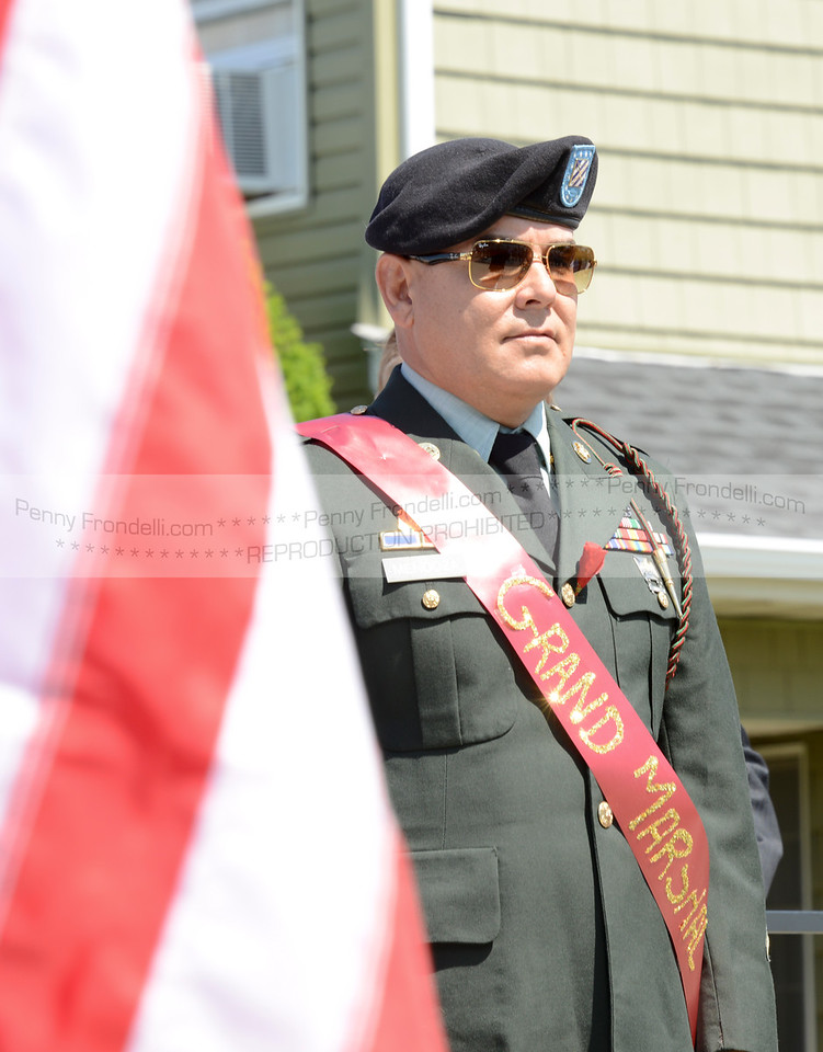 Fredy Mendoza - Grand Marshall at the Island Park Memorial Day Parade during opening prayers at the service.<br /> Mendoza serverd in the Army 2006-2009 in Iraq, He became a US citizen during deployment