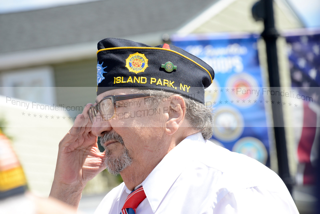 Willie Carrollo salutes the flag at the Memorial day serices in Island Park - served in the Army  from 1953-1955 Korea