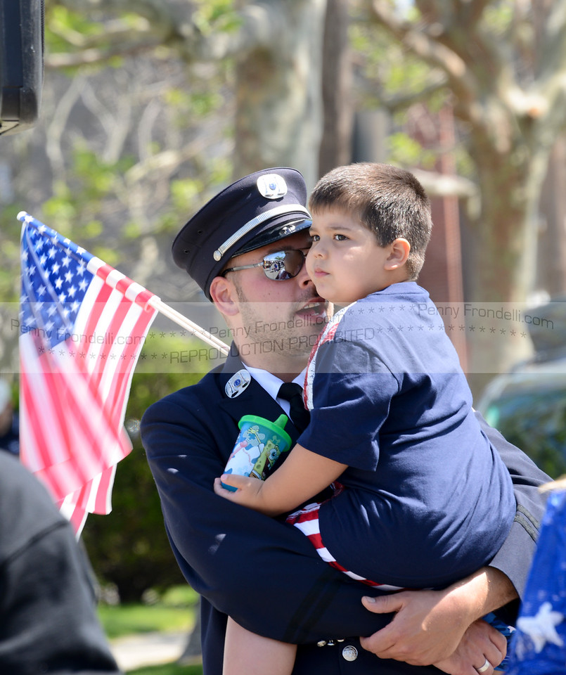 Captain of the IP fire dept Jason Cruz and his son Jordan 31/2 watch the memorial day services after they marched