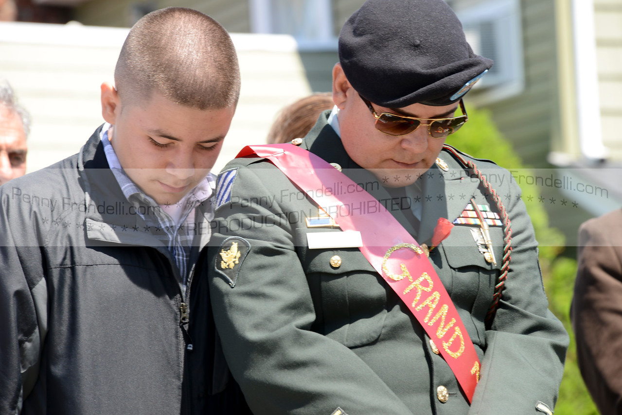 Woodrow Mendoza stands with his father Fredy Mendoza - Grand Marshall at the Island Park Memorial Day Parade during opening prayers at the service.<br /> Mendoza serverd in the Army 2006-2009 in Iraq, He became a US citizen during deployment