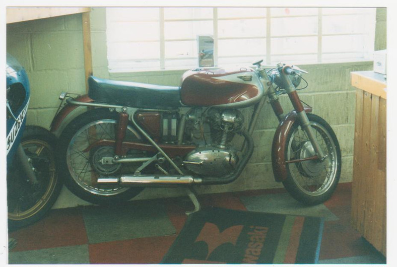 1 of 2 Ducati,s in Paul Smarts Kent bike shop. His Imola race bike had left to go on display at the factory a month before. The other Ducati there was Foggy,s #4 Superbike.<br /> Thats one of those common old TR 750 Suzuki,s poking its head in.