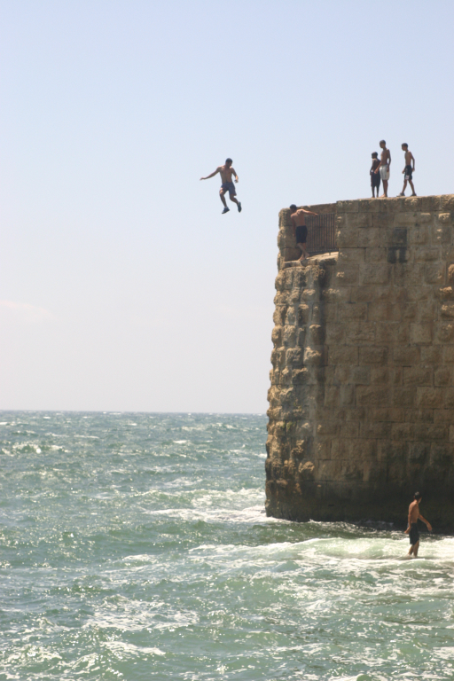 In the Acco harbor, youths jumped into the ocean, thrilling onlookers