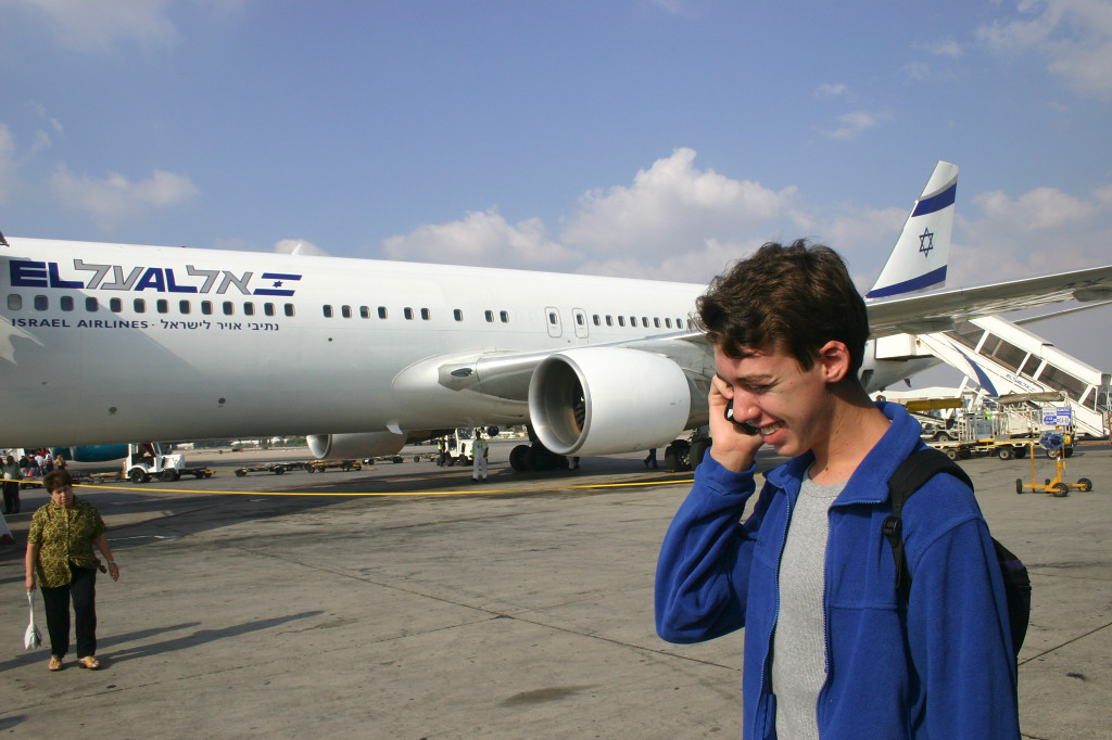 Just off the plane in Tel Aviv. Letting mom know we got there OK