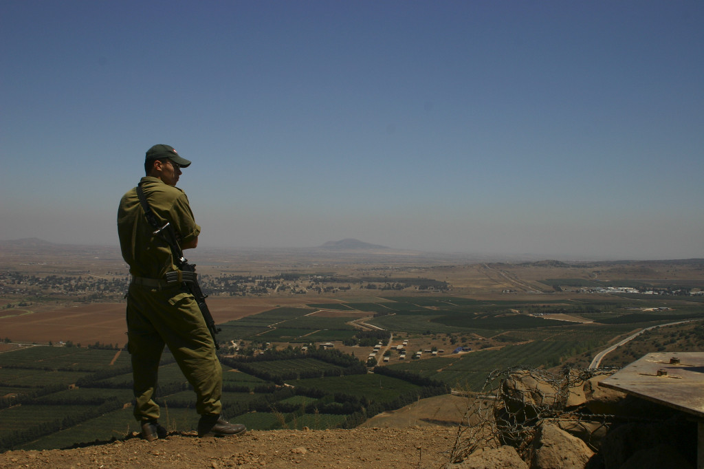 A  soldier on Mt. Bental looks east. In the mid distance the town of Kuneitra, the border now between Syria and Israeli occupied Golan. Damascus is only 40 miles away