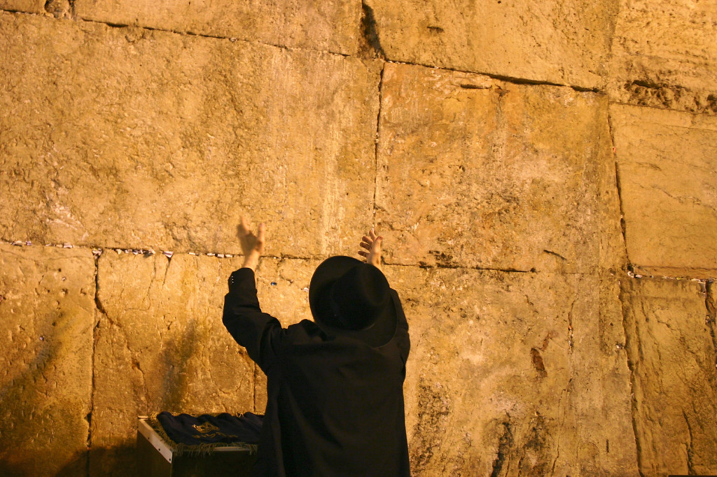Our last day. Back to the Western Wall again. A man raises his arms in supplication and prayer