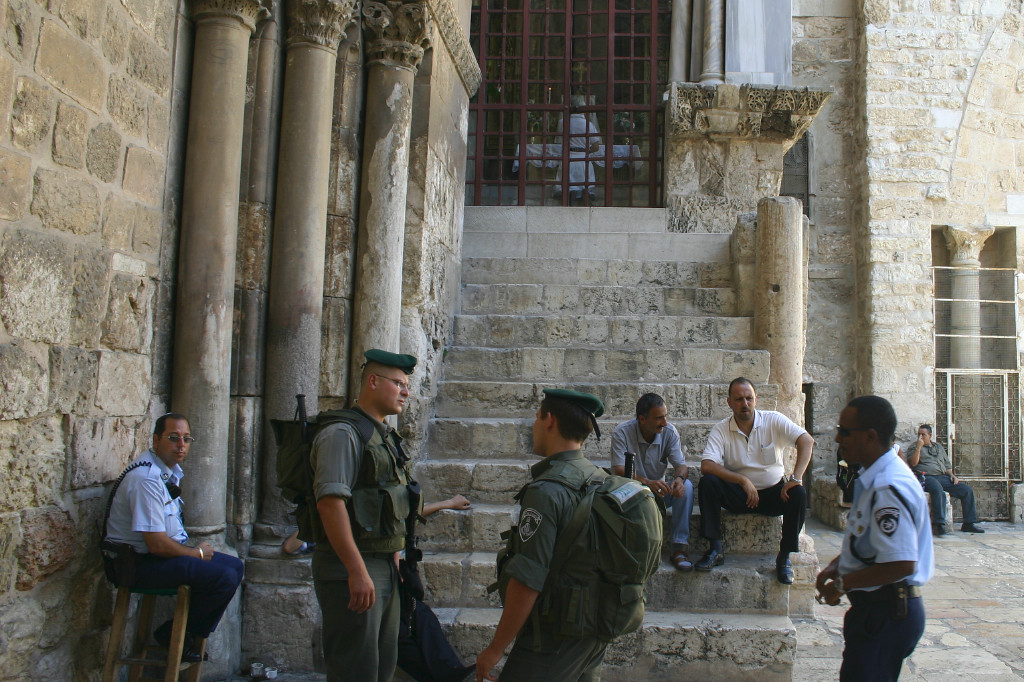 Outside, a symbol of Jerusalem: The police (in blue shirts) include a Jew, a Muslim and a Christian. The more heavily laden ones in green are the Border Police