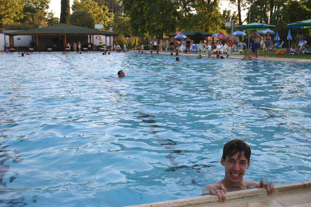 Max swims in the kibbutz pool, an Olympic size one