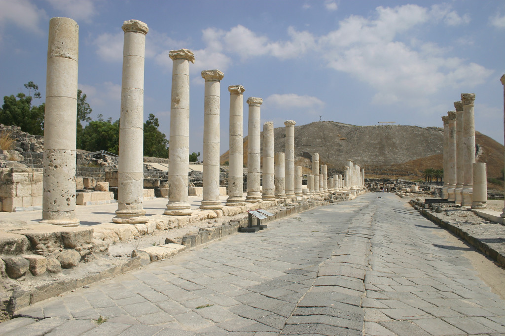 "The reconstructed main drag. In the background, the ancient ""tel"" (dozens of layers of cities built on over the other) was ancient even to the Romans"